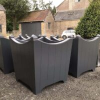 group of somerville planters painted ready for planting