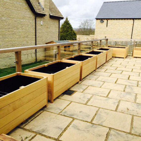 hardwood trough planters ready to be planted